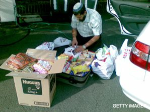 FOOD AND THOUGHT: David Alima, an Israeli rabbi who has moved to Zimbabwe, packed food in South