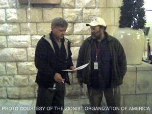 Handout: Yosef Hartuv, one of the activists who was detained, hands a booklet to a Fox News cameraman.