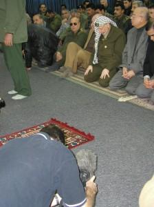 Yaser Arafat praying at a Ramallah mosque