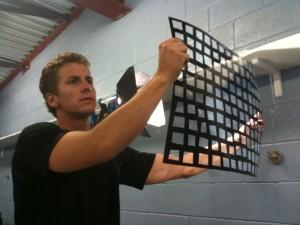Dan Lowrey helps light the set