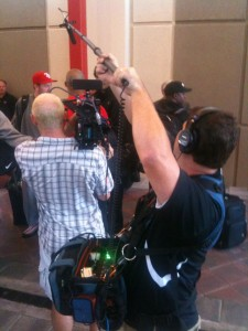 """DP """"Boomer"""" Alred and John DeMaio capture Buc's players getting their plane tickets"""