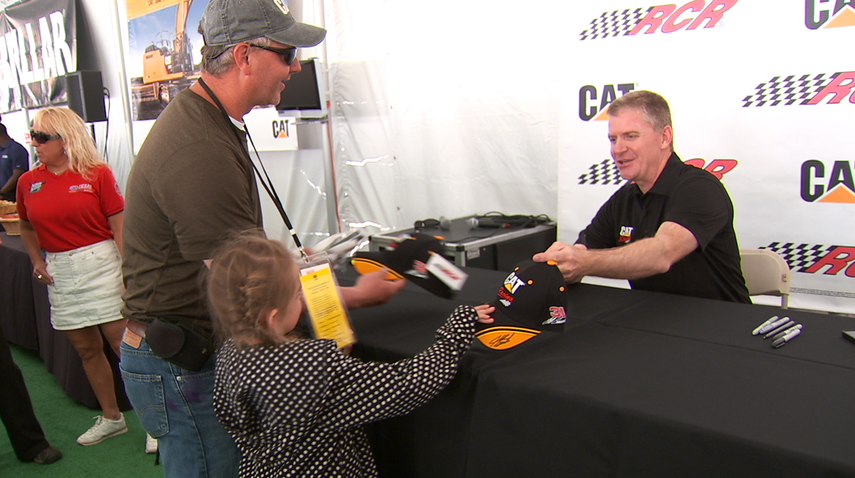 Jeff Burton signs some autographs for fans.