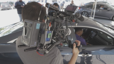Dallas cameraman, Nate Galluppi, captures some people interacting with Honda's bluetooth technology.