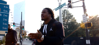 Devonta Freeman 4 400x184 Atlanta Crew Walks a Mile in Freeman's Cleats for Bleacher Report