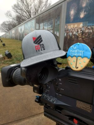 TWC with Hat and Cookie 300x400 Video Production Crew Braves the Winter Weather with The Weather Channel