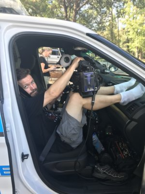 "Dave in police car with socks e1520436537857 300x400 Charleston, South Carolina Video Camera Crew Goes on K 9 Patrol with A&E's ""Live PD"""
