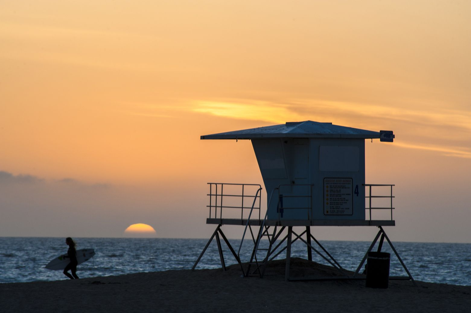 lifeguard tower with sunset