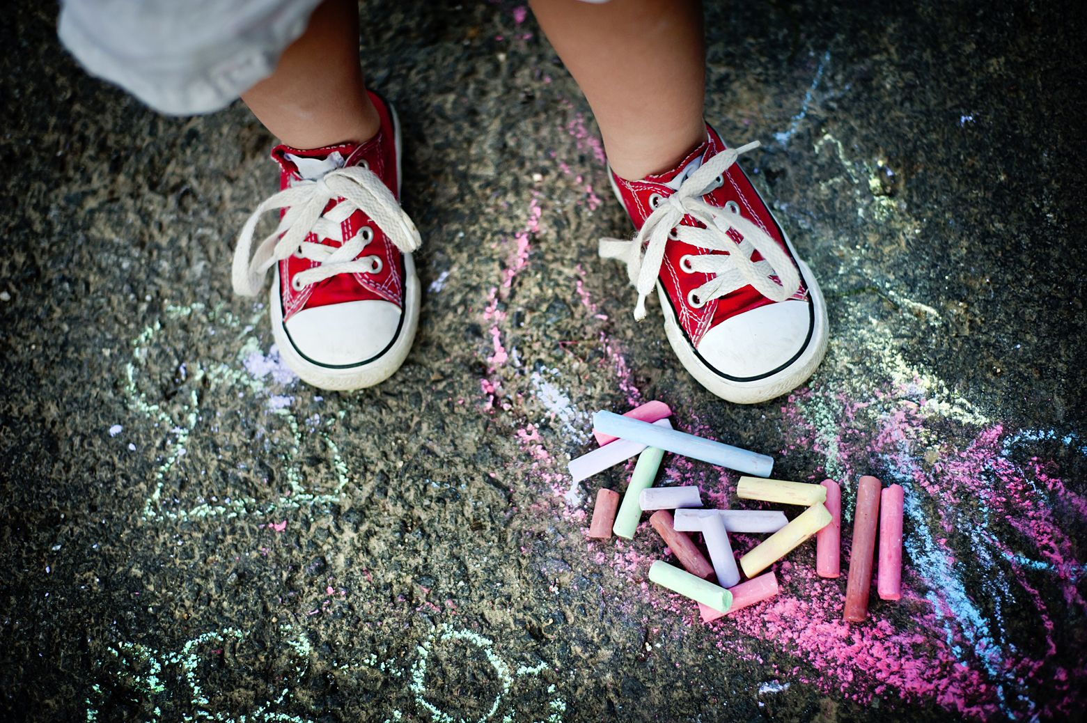 child's shoes and chalk on the ground