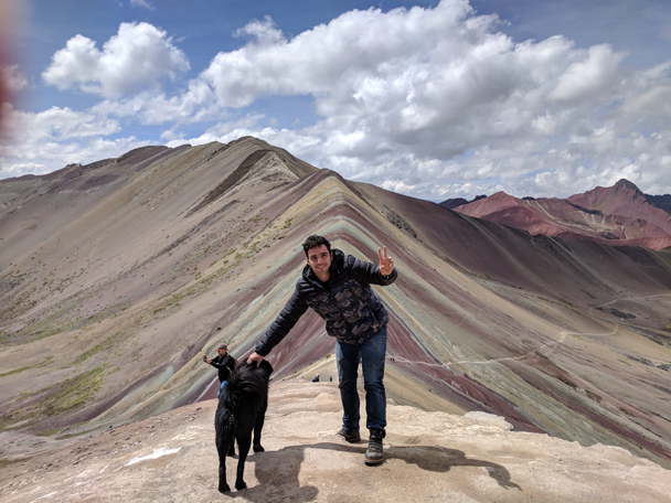 Rainbow Mountain with a dog that traveled with us