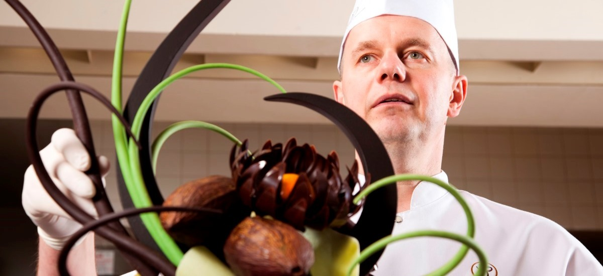 Pastry chef with elaborate chocolate sculpture