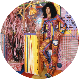 Kenny Scharf in multicoloured bodysuit
