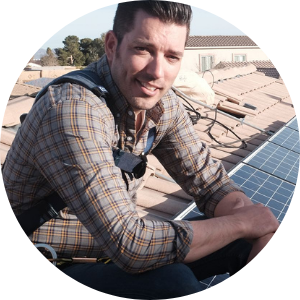 Jonathan Scott on roof beside solar panels