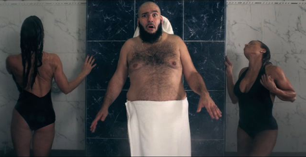 chromeo's p-thugg stands half-naked, with his mouth agape, between two insanely hot models in the shower