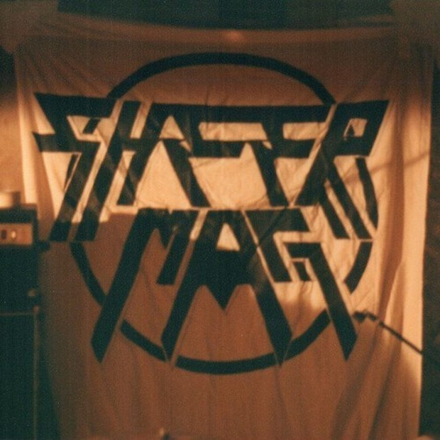 """white sheet backdrop with """"Sheer Mag"""" in Thin Lizzy lettering"""