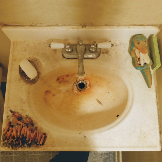 bathroom sink and cigarette butts