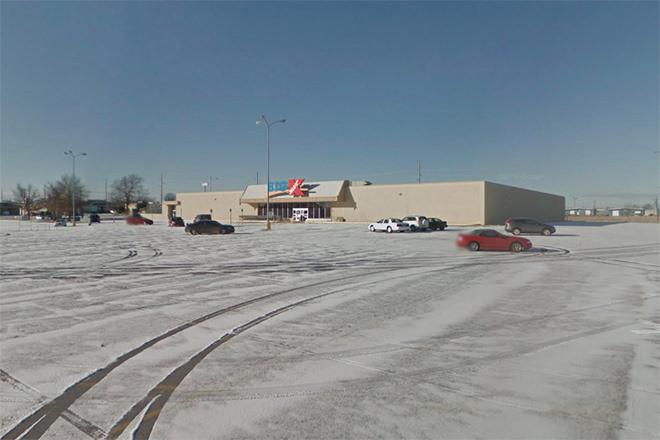 Empty Kmart in Springdale Sparks Suit