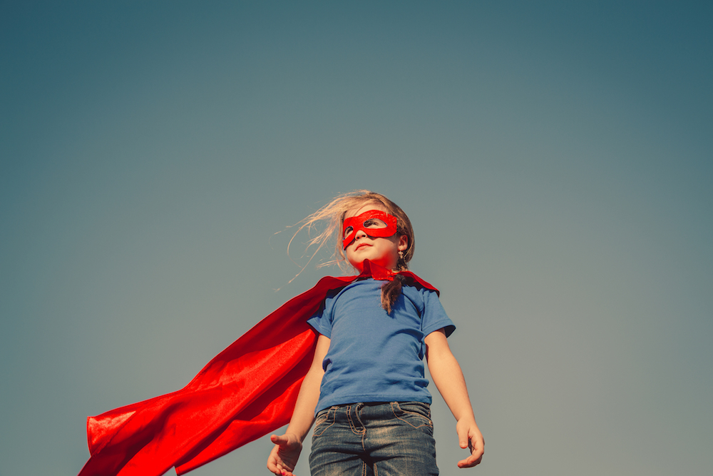 Superhero girl in cape