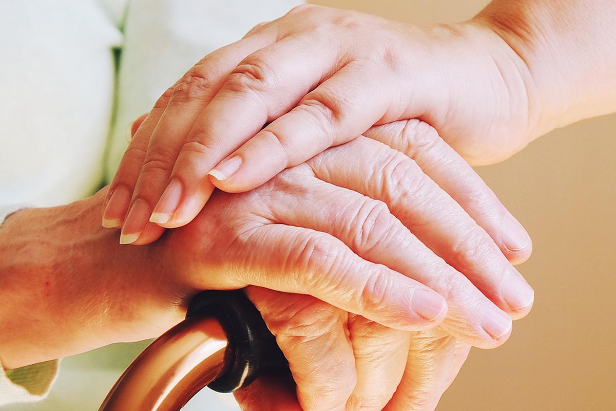 Caregiver folded hands shutterstock 126300