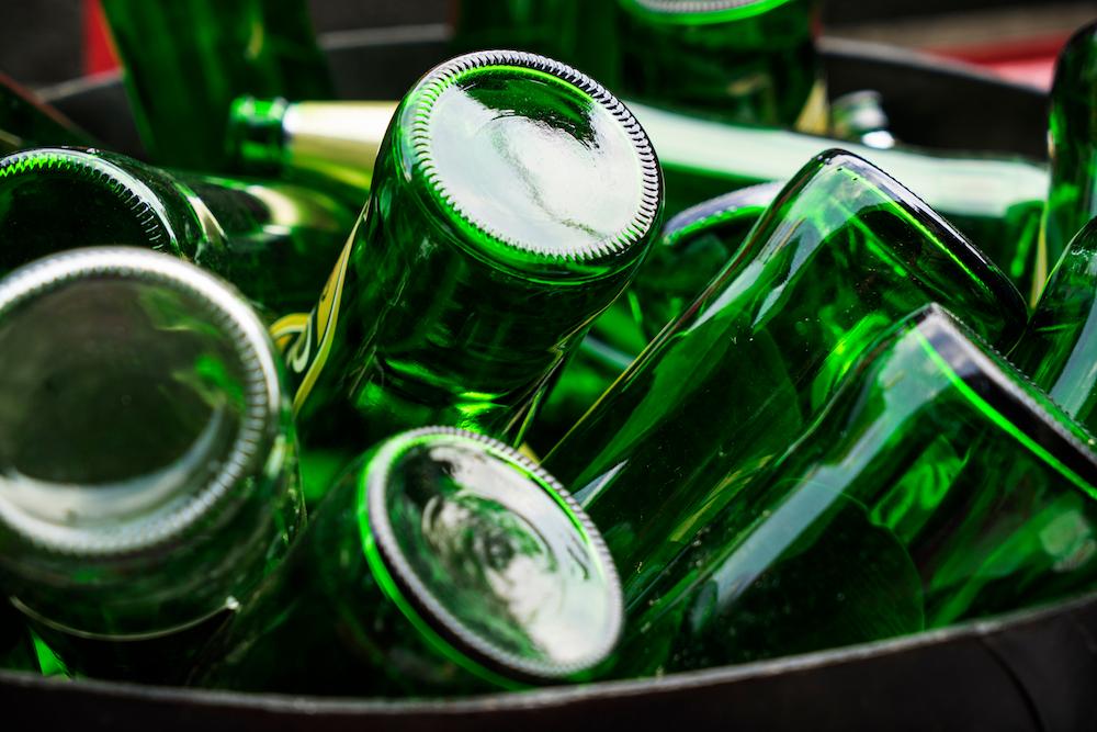 Empty glass bottles recycling