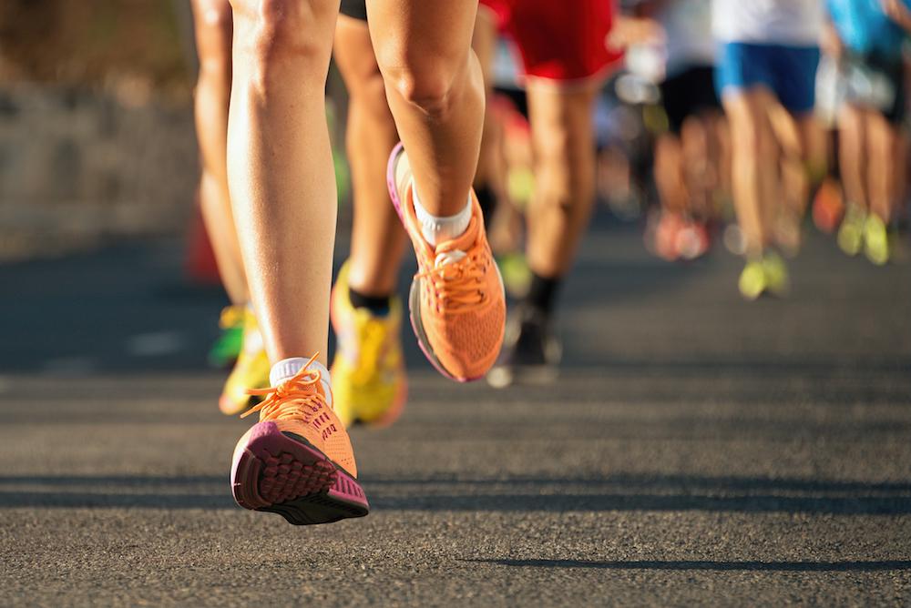 Runners running marathon 5K wellness