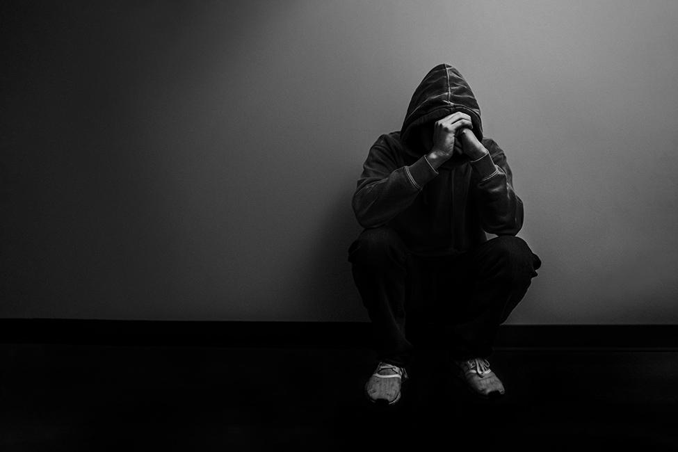 teen crouching black and white 129275 pediatrics plus