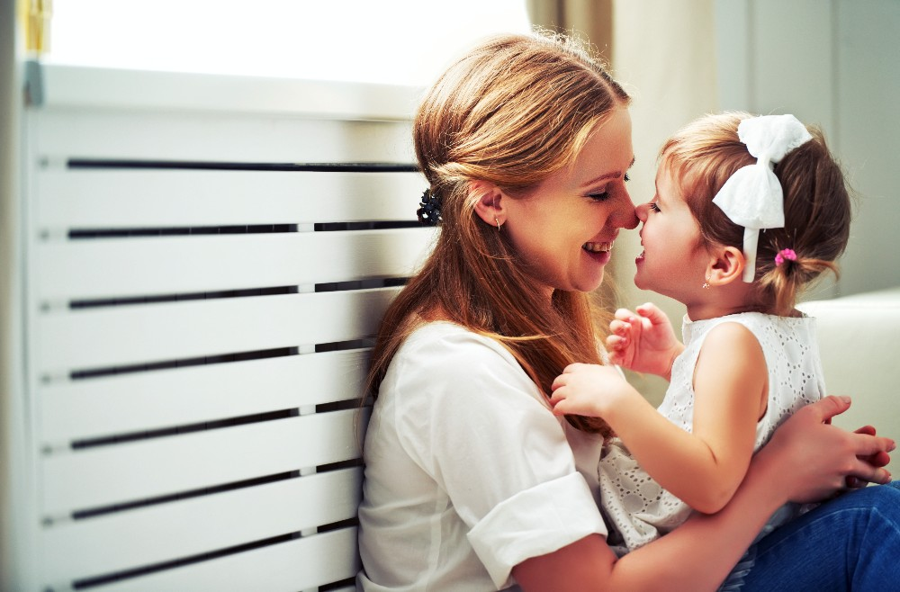 mother playing with child at home