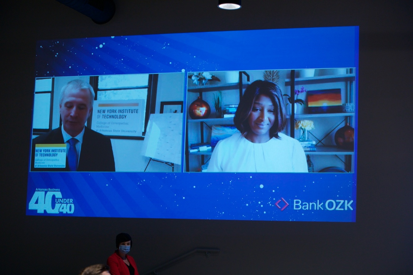 40 Under 40 honoreeDr. Brookshield Laurent appears via live video, greeted by Dr. Shane Speights, dean of the New York Institute of Technology College of Osteopathic Medicine at Arkansas State University.