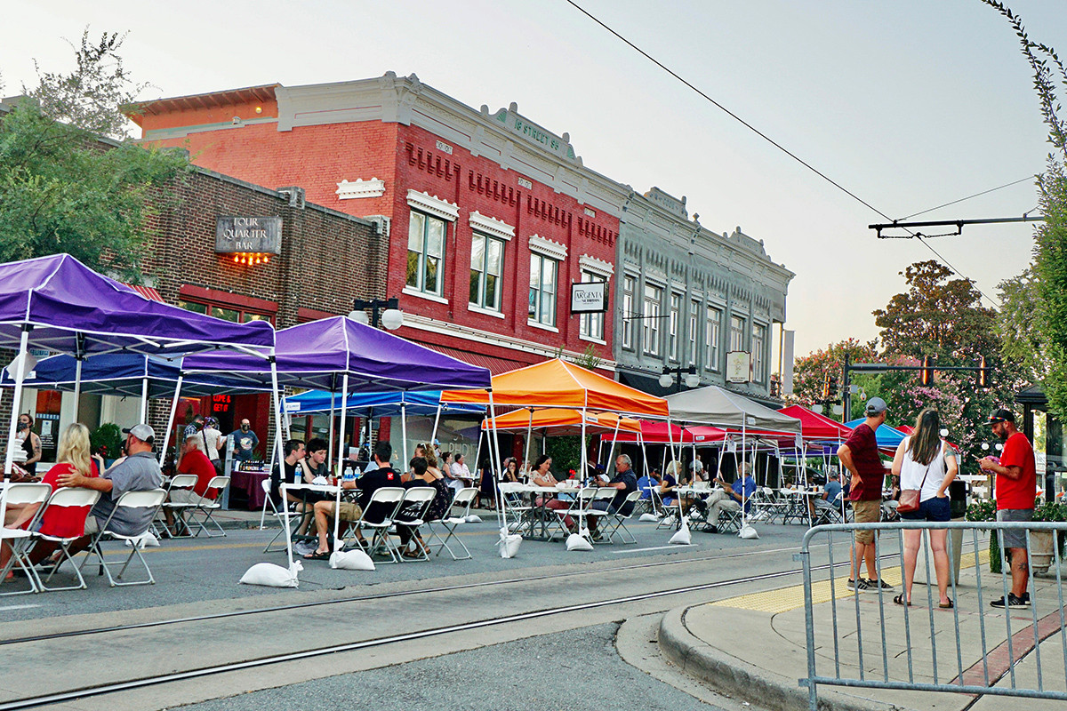 The Argenta Outdoor Dining District had its grand opening Aug. 7-8 on a blocked-off Main Street in North Little Rock, where two dozen tents held tables filled with diners. Brood & Barley and the Four Quarter Bar participated, and Ristorante Capeo offered service from its dining room at the end of the block.