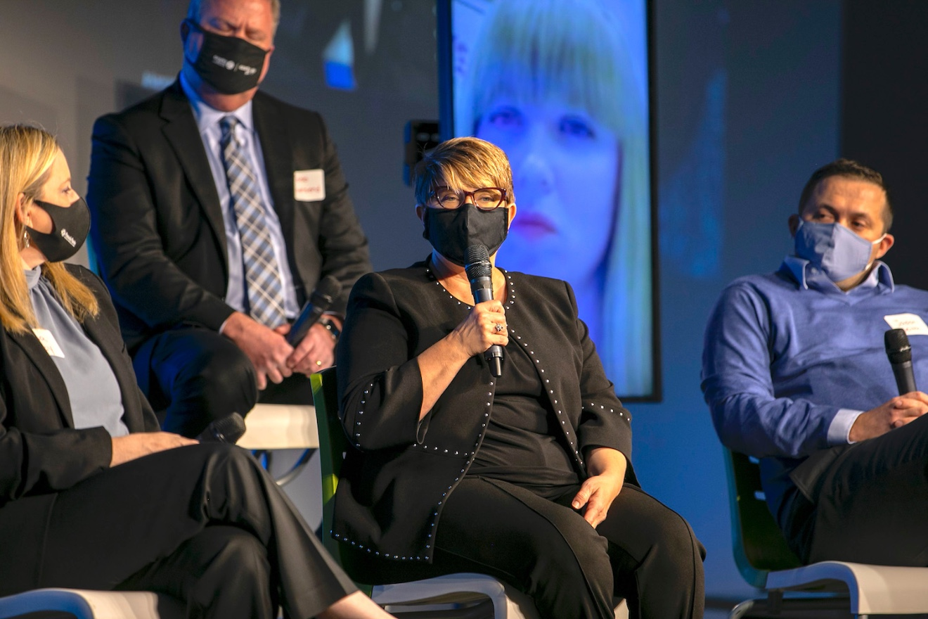 Kimberly Hadley (center) ofJohn Brown University of Siloam Springs speaks during a panel discussion of CFO of the Year Award winners.