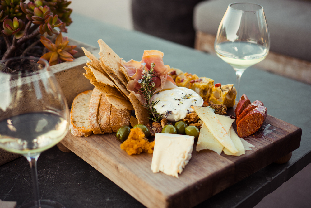Charcuterie board and cheese with wine