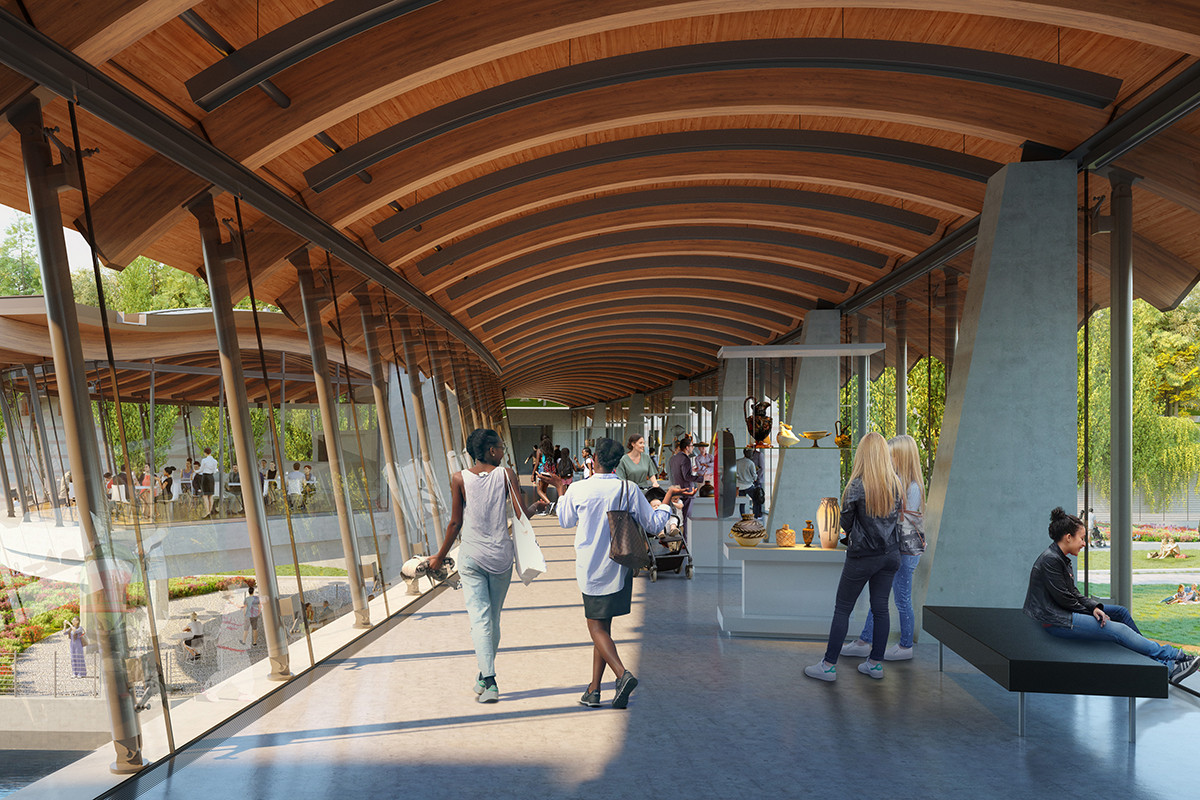 A new bridge will connect two galleries, as seen in this artist's rendering, looking toward the Crystal Bridges cafe and natural surroundings.