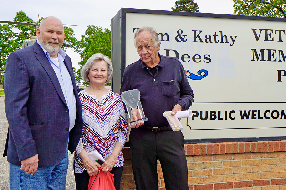 """Greater Berryville Chamber of Commerce Executive Director Dean Lee with longtime friends Kathy and Tom Dees at a dedication of Holiday Island's Veterans Memorial Park in their honor. Dees was initially against the idea. """"I don't want my name on anything,"""" he said."""
