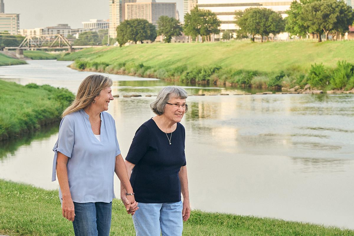 North Texas Caregiver 137209 mother daughter walk park