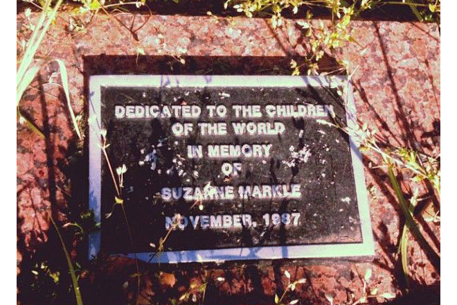 A plaque at Gibbs International Magnet School in Little Rock in memory of Suzanne Markle, who was murdered by her father, along with her mother and sister, in November 1987.