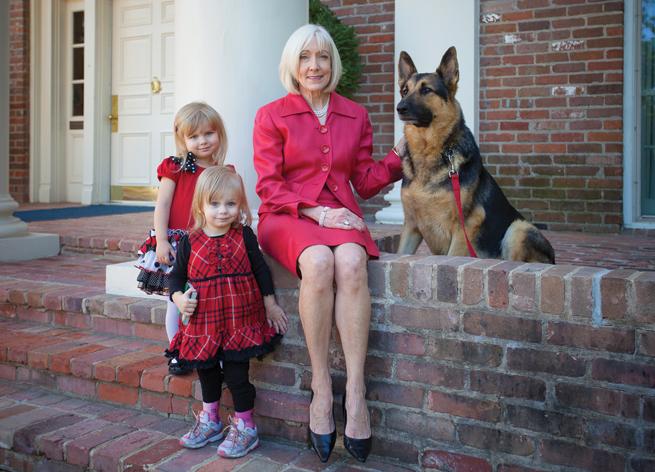 Ginger Beebe & granddaughters front porch German Shepherd