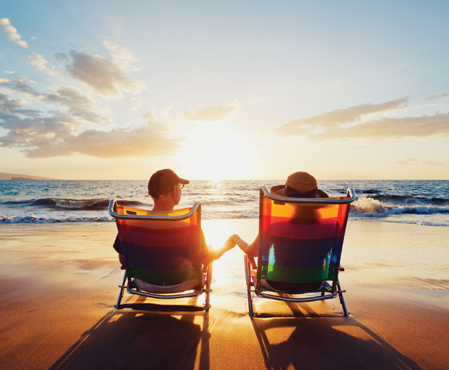 honeymoon couple beach chairs sunrise sunset waves ocean