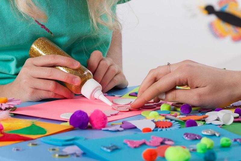 Child making crafts, craft supplies, art supplies,