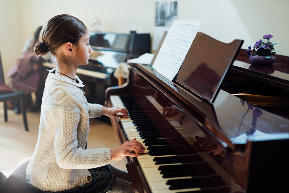 child playing piano lesson