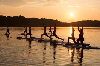 Go Into the Wild with This SUP Yoga 501 Retreat