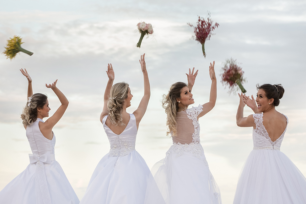 four brides tossing bouquets shutterstock