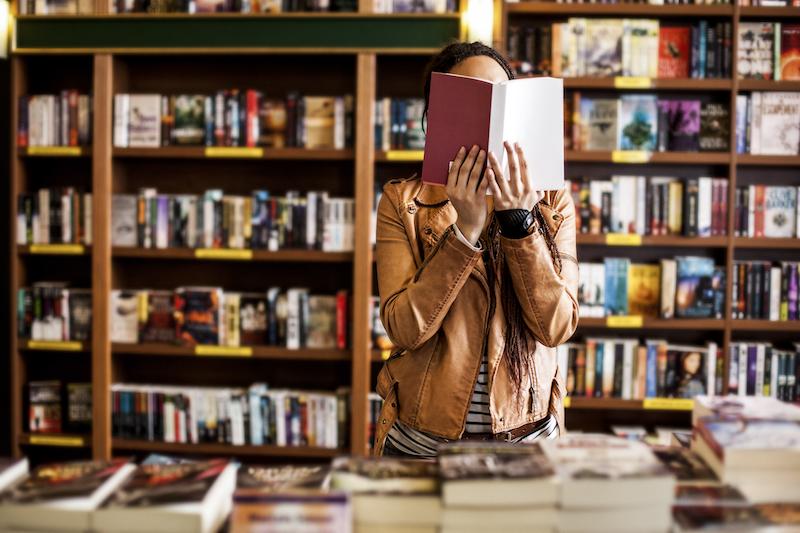 woman in bookstore shutterstock