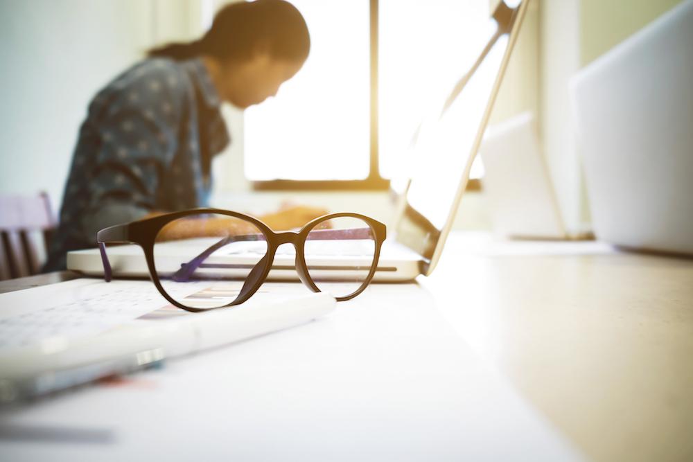 Office desk, laptop, computer, glasses shutterstock