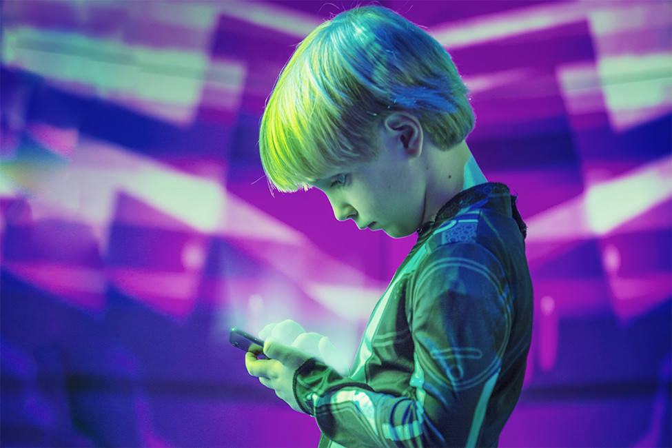 LRF Boy looking down at mobile device cellphone illustration
