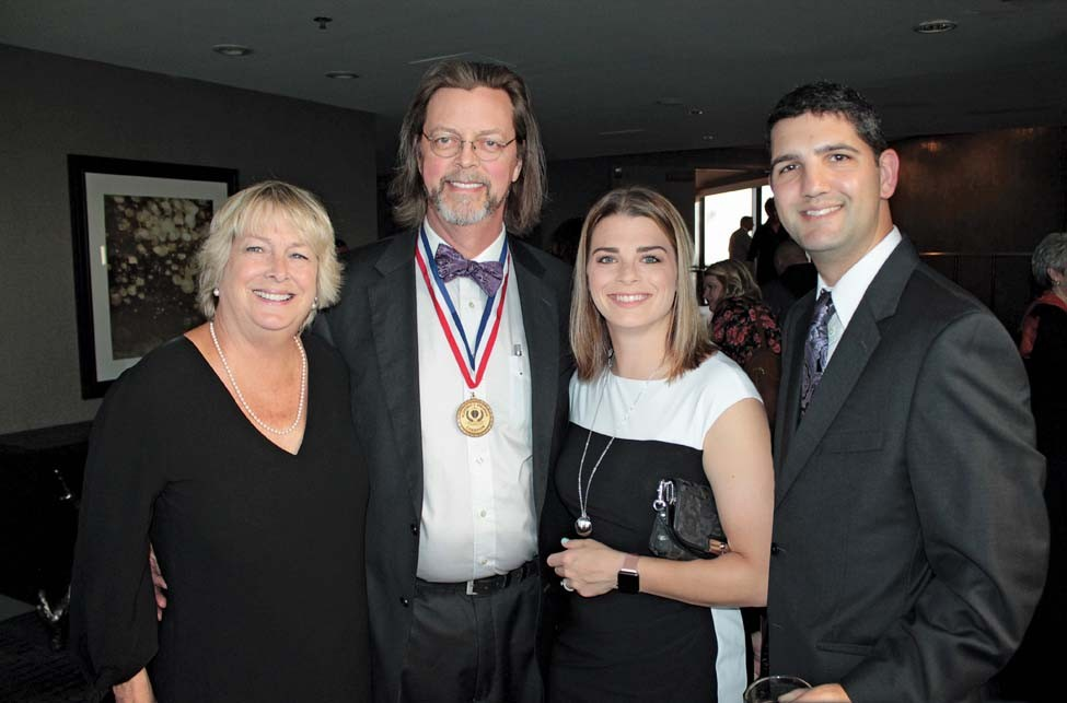 Beth and Dr. Mark Pippenger, Caroline and Jared Azzone