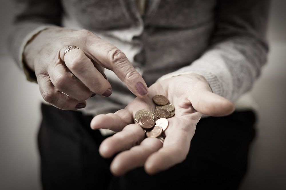 senior-woman-counting-coins