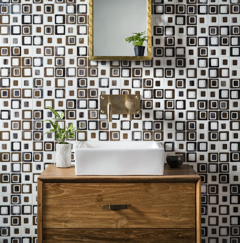 Vignette photography of Devotion glass tile line includes new patterns and new Italian glass and antique mirror.