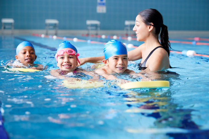 Should my child take private or group swim lessons?