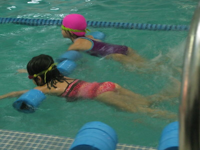 group swimming lessons vs private swimming lessons for kids