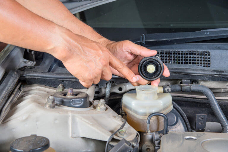 Pointing at Brake Fluid Resevior