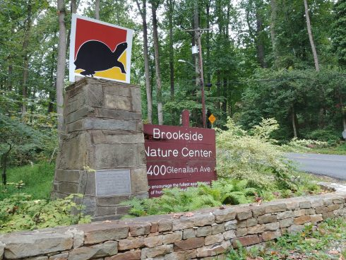 Brookside Nature Center main entrance sign with turtle logo